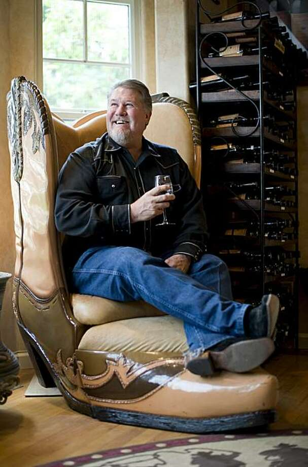 Scott Shaw, owner of Burns Cowboy Shop, has a seat and glass of wine in the huge cowboy boot chair seen in the Galante Vineyards tasting room in Carmel-by-the-Sea, Calif., on Wednesday, September 8, 2010. Photo: Chad Ziemendorf, The Chronicle