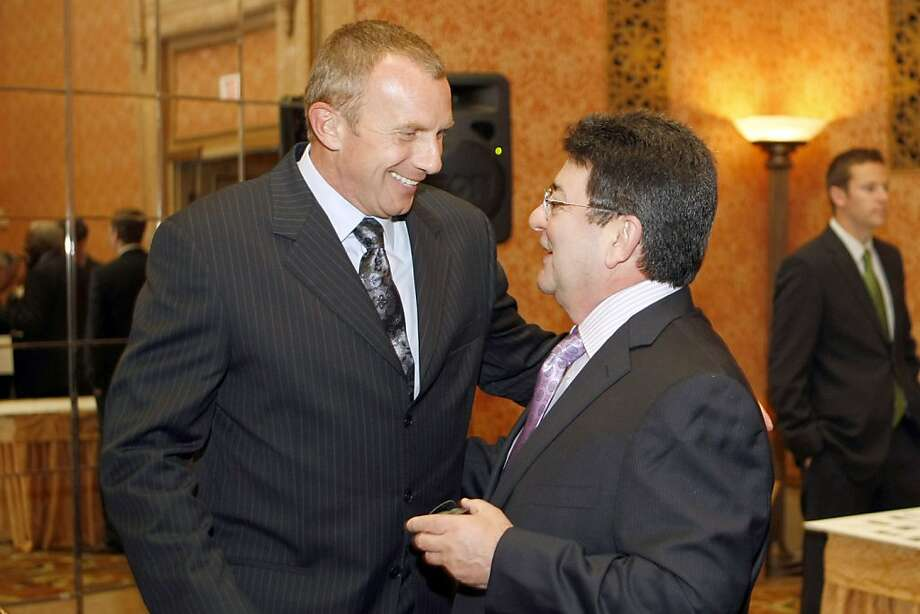 Former 49er quarterback Joe Montana (left) meets former 49er owner Eddie DeBartolo, Jr. prior to the enshrinement. Montana, already in the Bay Area Sports Hall of Fame was at the event as a presenter. Football greats Roger Craig, Ray Guy and Burl Toler Sr., record-breaking swimmer Rick DeMont, and under a new ÒDistinguished AchievementÓ category, former 49er owner Eddie DeBartolo, Jr., have been elected to the Bay Area Sports Hall of Fame. They were honored at BASHOFÕs 29th Annual Enshrinement Banquet on Monday, April 21, 2008 at the Westin-St. Francis Hotel in San Francisco, Calif.  Photo by Michael Maloney / San Francisco Chronicle Photo: Michael Maloney, SFC