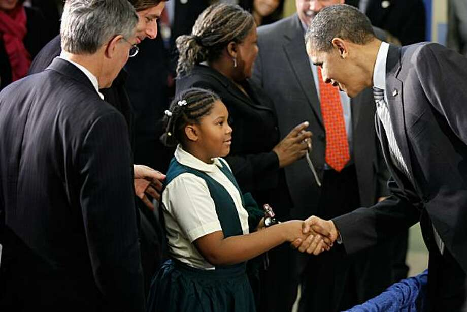 WASHINGTON, DC - DECEMBER 13:  (AFP OUT) U.S. President Barack Obama (R) greets a young student after signing the Healthy, Hunger-Free Kids Act of 2010 at Harriet Tubman Elementary School December 13, 2010 in Washington, DC. In an effort to provide children with better school lunches and breakfasts, the new law puts $4.5 million in the hands of child nutrition programs, sets nutrition standards on school vending machines, helps create school gardens and makes sure that quality drinking water is availableduring meal times. Photo: Chip Somodevilla, Getty Images
