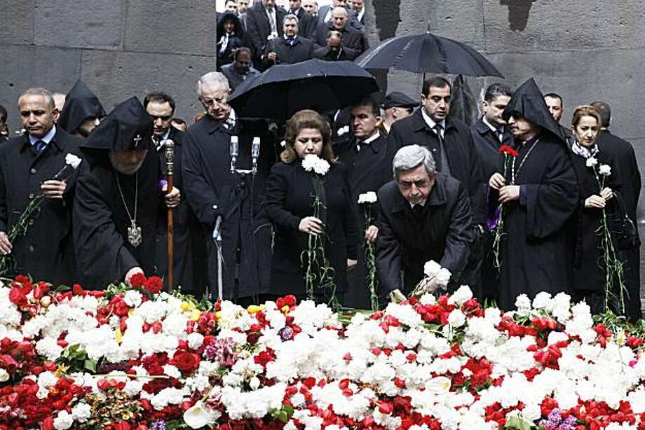 Armenia's President Serzh Sarksyan (R), his wife Rita and the Catholicos of All Armenians Garegin II (L) attend in Yerevan on April 24, 2010 the ceremony marking the 95th anniversary of the 1915 mass killing of Armenians in the Ottoman Empire. Armenians demand that Turkey regognizes the genocide of 1.5 million of their kin killed between 1915 and 1917 by the Ottoman Empire, Turkey's predecessor. In rejecting the genocide label, Turkey says between 300,000 and 500,000 Armenians and at least as many Turks died in civil strife when Armenians took up arms in eastern Anatolia and sided with invading Russian troops. Photo: Davit Hakobyan, AFP/Getty Images