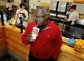 Jamba Juice president and CEO James D. White enjoys his favorite drink at the Emeryville, Calif. Jamba Juice Monday December 6, 2010.