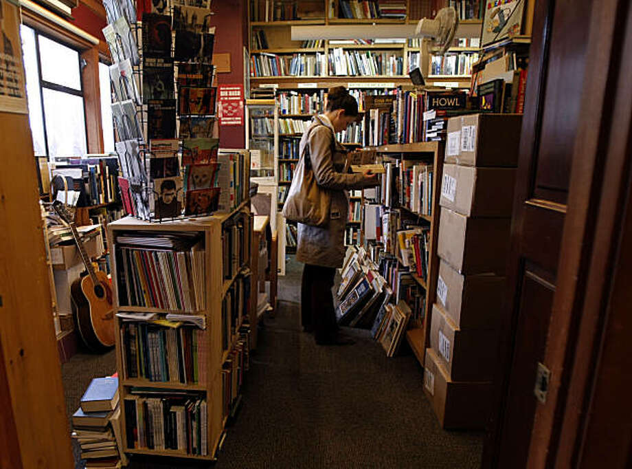 Fiona Carswell, a regular costumer, enjoys the art books and graphic novels at Bird & Beckett Books and Records in San Francisco, Calif., on Dec. 11, 2010. Photo: Michelle Gachet, The Chronicle