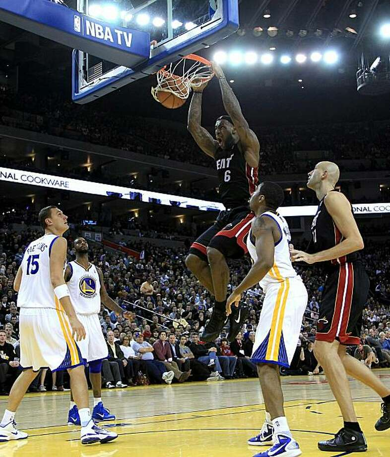 OAKLAND, CA - DECEMBER 10:  Lebron James #6 of the Miami Heat dunks the ball against the Golden State Warriors at Oracle Arena on December 10, 2010 in Oakland, California. NOTE TO USER: User expressly acknowledges and agrees that, by downloading and or using this photograph, User is consenting to the terms and conditions of the Getty Images License Agreement. Photo: Ezra Shaw, Getty Images