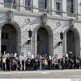 A growing crowd gathers outside the California Supreme Court on Tuesday in San Francisco to hear the decision about Proposition 8.