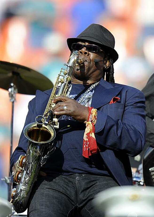 Saxophonist Clarence Clemons performs during halftime of the Tennessee Titans against the Miami Dolphins NFL football game, in this Nov. 14, 2010 file photo taken in Miami. Clemons is playing the national anthem on Sunday Dec. 12, 2010 at the Jets-Miami Dolphins football game in New Jersey, then heads to a California show next week. Photo: Rhona Wise, AP