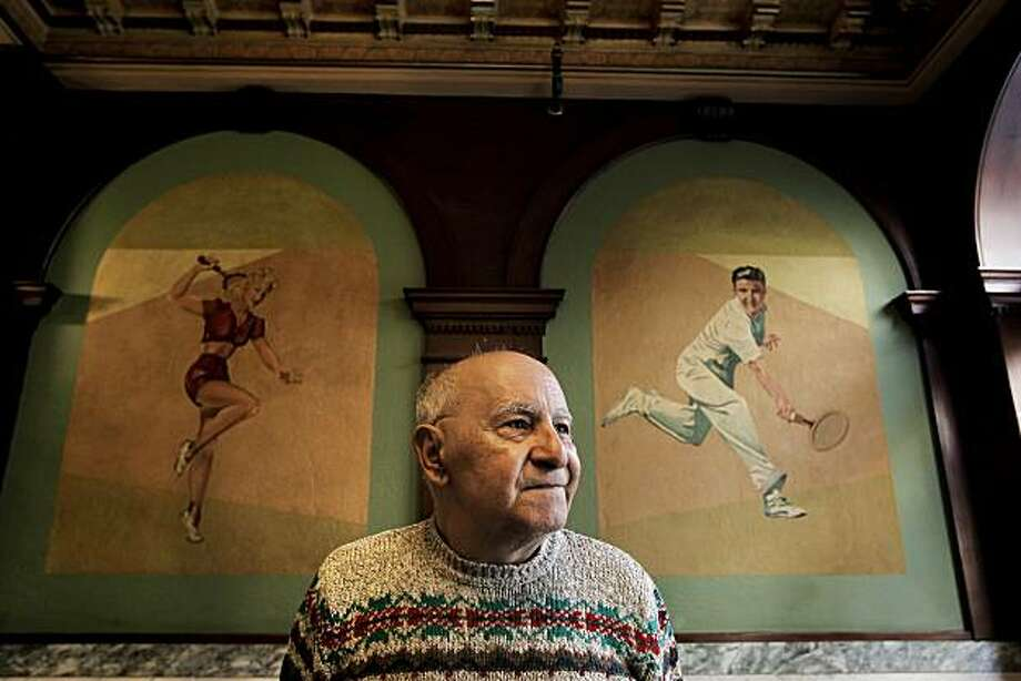 A tenant since 1997, Jack Harmon in the lobby of the Hotel Senate in the Tenderloin neighborhood, on Thursday Dec. 9, 2010, in San Francisco, Calif. Harmon standing near some of the many athletic murals that grace the walls of the hotel which is about to undergo renovations for the senior and low income tenants. Photo: Michael Macor, The Chronicle