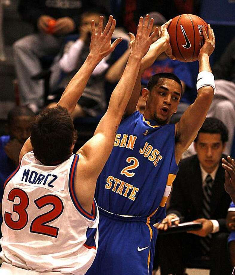 San Jose State's Adrian Oliver (2) looks to pass as Boise State's Zack Moritz (32) defends during the second half of an NCAA college basketball game on Saturday, March 6, 2010 in Boise, Idaho. (AP Photo/Matt Cilley) Photo: Matt Cilley, ASSOCIATED PRESS