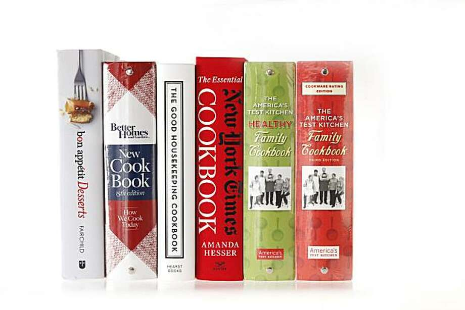 "Left-right: ""bon appetit Desserts"" by Barbara Fairchild, , ""New CookBook 15th edition"" by Better Homes and Gardens, ""The Good Housekeeping Cookbook 125th Anniversary,"" ""The Essential New York Times Cookbook"" by Amanda Hesser, ""The America's Test Kitchen Healthy Family Cookbook,"" and ""The America's Test Kitchen Family Cookbook Third Edition"" as seen in San Francisco, California, on December 7, 2010. Photo: Craig Lee, Special To The Chronicle"
