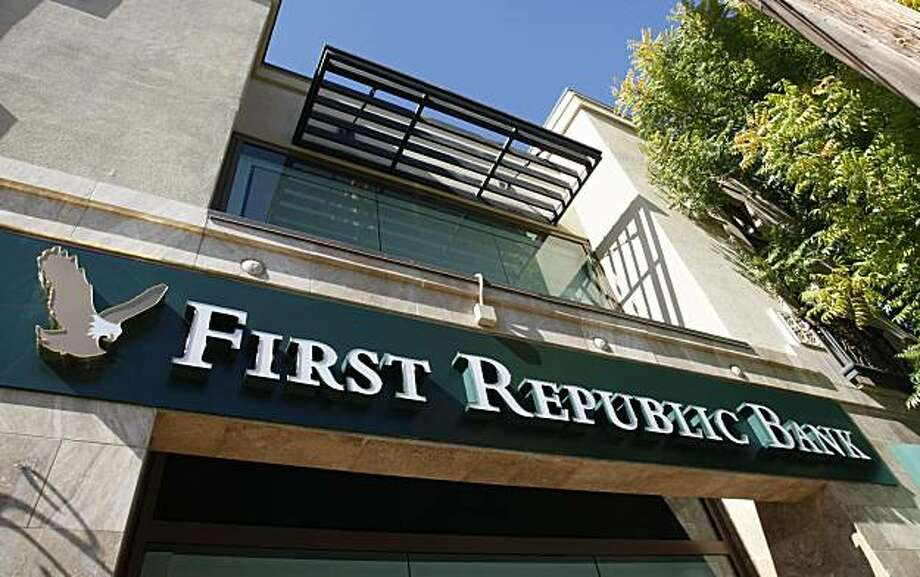 A First Republic Bank in Palo Alto, Calif. is shown Wednesday, Oct. 21, 2009. Bank of America Corp. has agreed to sell First Republic Bank, a private bank it inherited from Merrill Lynch & Co., to a group of investors for more than $1 billion, according to a report Wednesday by The Wall Street Journal. (AP Photo/Paul Sakuma) Photo: Paul Sakuma, AP