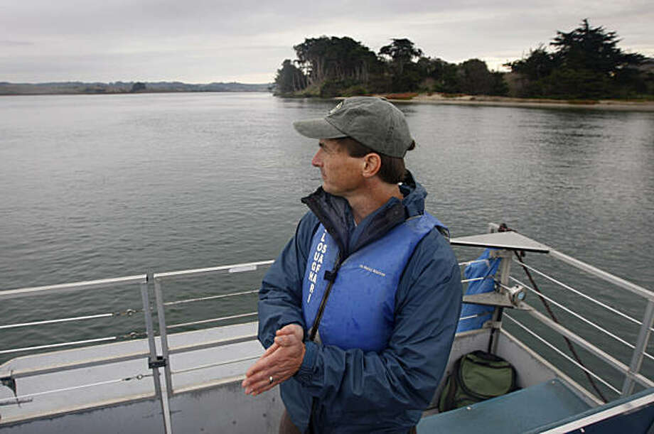 Bryan Largay takes in the view from a boat in Elkhorn Slough at Moss Landing, Calif., on Wednesday, Dec. 8, 2010. Largay is director of the Tidal Wetland Project, which is constructing a submerged steel wall three miles into the slough that is designed to slow the outgoing tidal flow in an effort to reduce erosion and protect the habitat of hundreds of marine species. Photo: Paul Chinn, The Chronicle