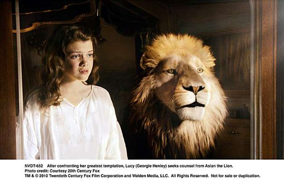 After confronting her greatest temptation, Lucy (Georgie Henley) seeks counsel from Aslan the Lion. Photo: Photo Credit: Courtesy 20th Cent, Twentieth Century Fox
