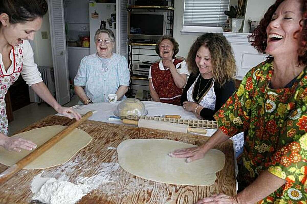 Sarah Ballard, Ann Capurro, 90, Anna Ballard, 81, Nancy Ballard, and Trish Ballard gather in the Ballard kitchen for an annual holiday ravioli making tradition on Friday Dec. 3, 2010 in San Francisco, Calif.