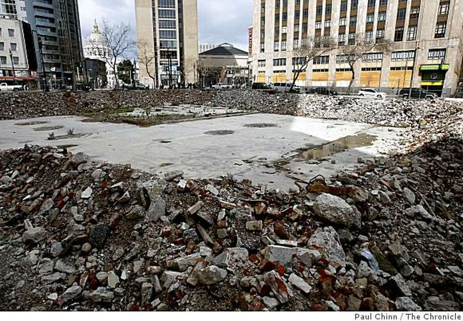 Developers are hoping to build a condo project on a vacant lot located on the southwest corner of Tenth and Market streets, seen in San Francisco, Calif., on Friday, March 6, 2009. Photo: Paul Chinn, The Chronicle