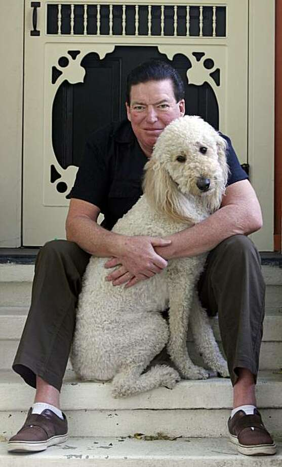 Kenney Dale Johnson, Chris Isaak drummer for the past 25 years relaxes at his Marin County home with his best friend Sunny Thursday Nov. 18, 2010 Photo: Lance Iversen, The Chronicle