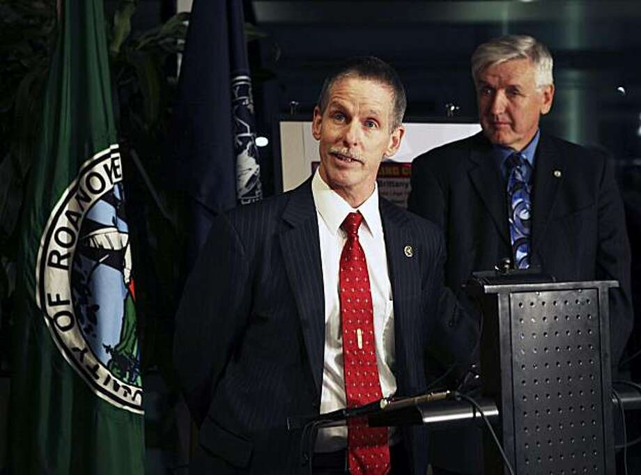 Kevin Foust, with the FBI, speaks during a news conference, as Capt. George Austin, Jr. from the Virginia State Police looks on Friday, Dec. 10, 2010 in Roanoke, Va. A 12-year-old girl who had been missing for a week was found unharmed Friday after she and the man accused in her abduction were recognized in a store in San Francisco, police said. Brittany Mae Smith has since been in touch with her family in Virginia, while Jeffrey Scott Easley, 32, was in police custody in San Francisco, Roanoke County Police Chief Ray Lavinder said at a news conference. Photo: Stephanie Klein-Davis, AP