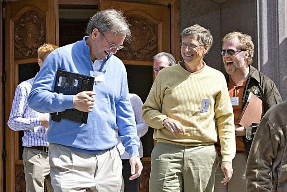 Eric Schmidt, chairman and chief executive officer of Google Inc., left, shares a laugh with Bill Gates, chairman of Microsoft Corp., center, and Nathan Myhrvold, founder and chief executive officer of Intellectual Ventures and former chief technology officer of Microsoft Corp., right, as they leave a session during the Allen & Co. Media and Technology Conference in Sun Valley, Idaho, U.S., on Thursday, July 9, 2009. The conference runs until Saturday, July 11. Photographer: Matthew Staver/Bloomberg News Photo: Matthew Staver, Bloomberg News