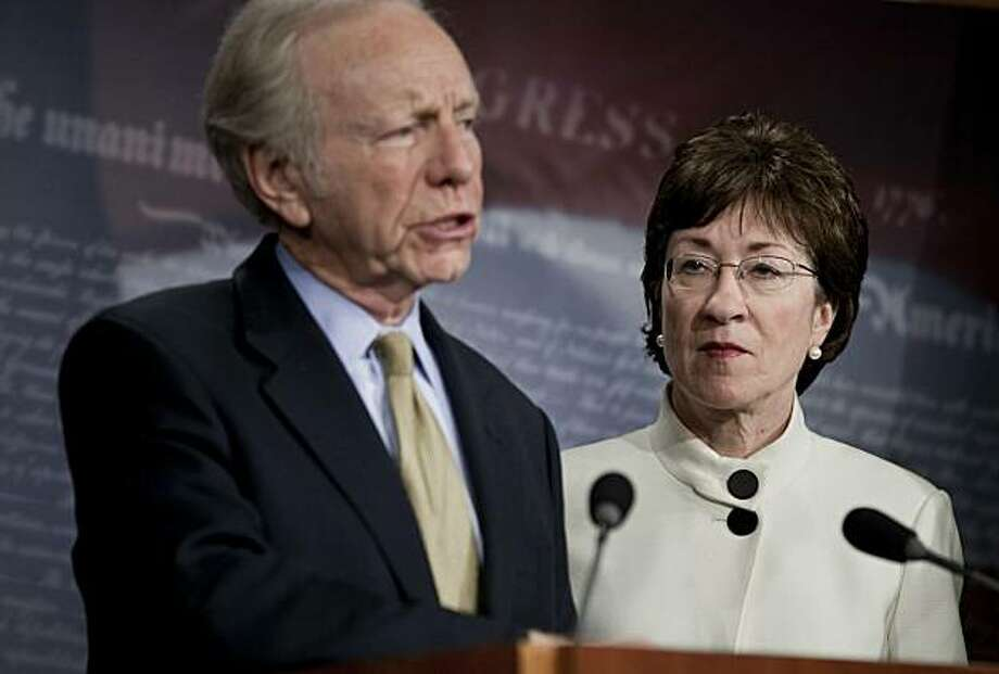 "WASHINGTON, DC - DECEMBER 9:  Senator Susan Collins (R-ME) (R) listens while Senator Joseph Lieberman (I-CT) speaks during a press conference on Capitol Hill December 9, 2010 in Washington, DC.  The US Senate was not able to get a 60 vote super majority necessary to move along a defense authorization bill that included language to repeal the US military's ""Don't Ask Don't Tell"" policy that prohibits gay service members from openly serving. Photo: Brendan Smialowski, Getty Images"
