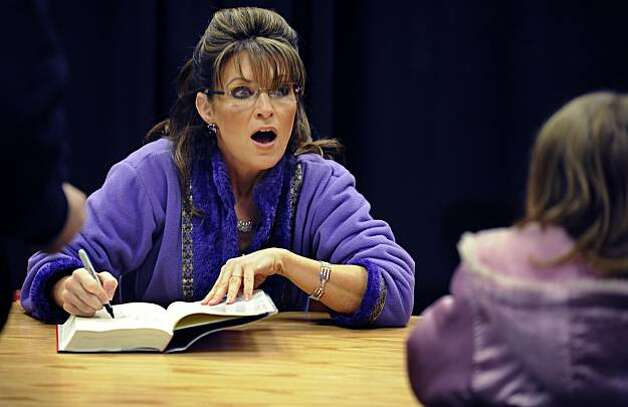 Sarah Palin talks to a young fan while at a book tour stop in Roanoke, Va., ...