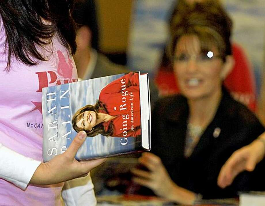 Sarah Palin interacts with a customer during a book-signing event in Henrietta, N.Y., Saturday, Nov. 21, 2009. Henrietta is a suburb of Rochester, N.Y. Photo: Don Heupel, AP