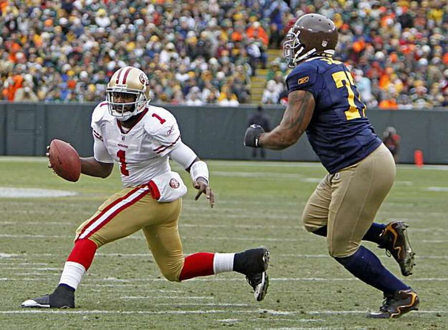 San Francisco 49ers quarterback Troy Smith tries to scramble away from Green Bay Packers defensive end Cullen Jenkins (77) during the first half of an NFL football game Sunday, Dec. 5, 2010, in Green Bay, Wis. Photo: Mike Roemer, AP