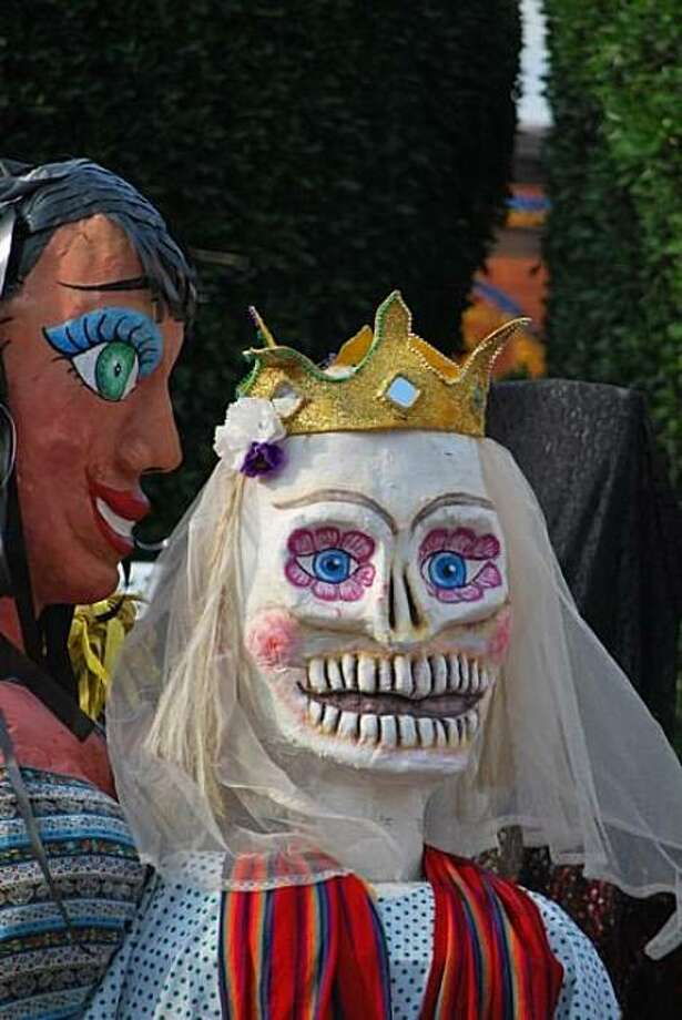 Fanciful puppets called mojigangas amuse onlookers during the Feast of Saint Michael the Archangel in San Miguel de Allende. Photo: Maribeth Mellin