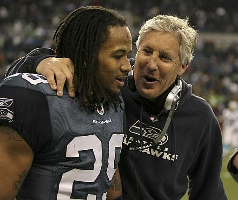 SEATTLE, WA - DECEMBER 05:  Head coach Pete Carroll of the Seattle Seahawks congratulates free safety Earl Thomas #29 near the end of the game against the Carolina Panthers at Qwest Field on December 5, 2010 in Seattle, Washington. The Seahawks defeated the Panthers 31-14. Photo: Otto Greule Jr, Getty Images