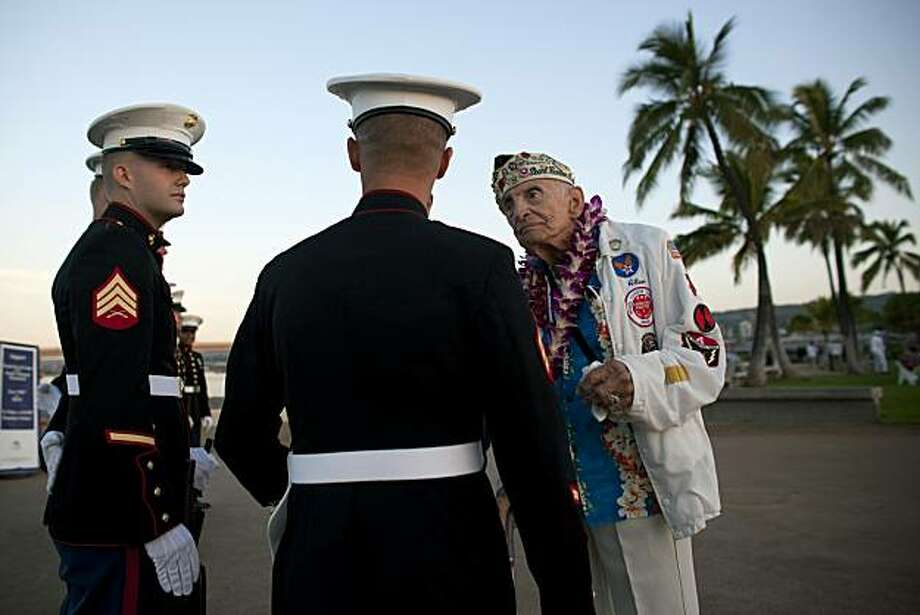 PEARL HARBOR, HI - DECEMBER 7:   Military veteran Allen Bodenlos, 90, (R) talks to members of a U.S. Marine firing detail during a memorial service for the 69th anniversary of the attack on the U.S. naval base at Pearl Harbor on the island of Oahu on December 7, 2010 in Pearl Harbor, Hawaii. On the morning of December 7, 1941 a surprise military attack was conducted by aircraft of the Imperial Japanese Navy against the U.S. Pacific Fleet being moored in Pearl Harbor becoming a major catalyst for the United States entering World War II.  In the devastating attack over 2,400 people were killed and thousands wounded, and dozens of Navy vessels with were either sunk or destroyed. Photo: Kent Nishimura, Getty Images