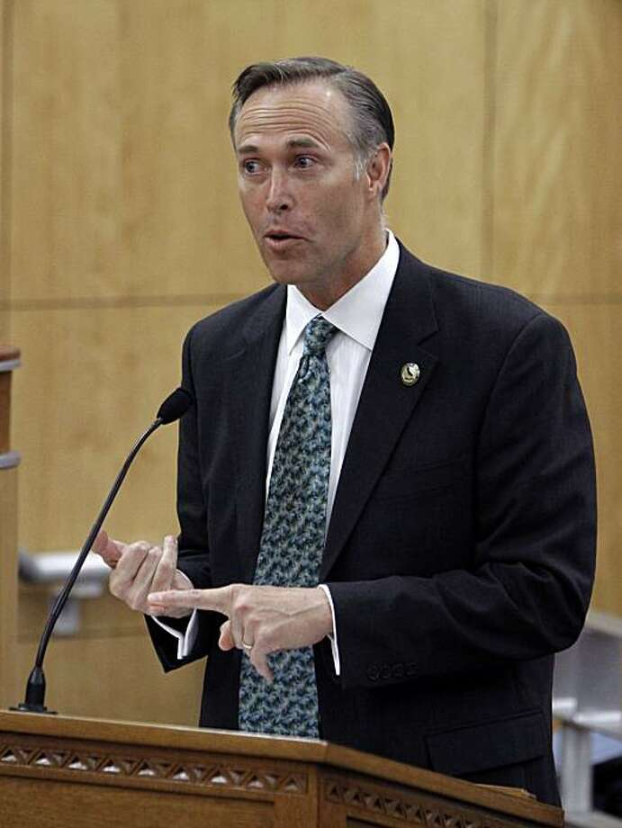 Assemblyman Jared Huffman, D-San Rafael, lists some of the reasons for his measure to impose a two-year moratorium on the use of metal bats in high school baseball during a hearing at the Capitol in Sacramento, Calif., Wednesday, May 5, 2010. The bill, introduced after a 16-year-old pitcher for Marin Catholic High School was struck in the head by a line drive hit off  an aluminum bat, was approved by the Senate Education Committee 5-1.(AP Photo/Rich Pedroncelli) Photo: Rich Pedroncelli, AP