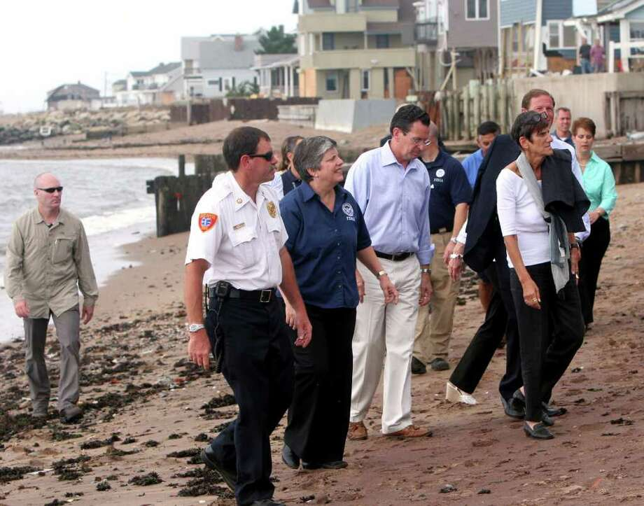 Homeland Security Secretary Janet Napolitano, third from left, Gov. Dan Malloy, center, and Congresswoman Rosa DeLauro, right, tour storm damage from Tropical storm Irene at Cosey Beach in East Haven on Monday, September 4, 2011. Photo: B.K. Angeletti / Connecticut Post