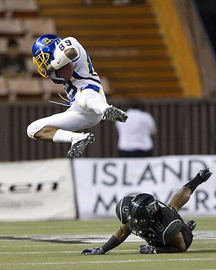 San Jose State wide receiver Chandler Jones is hit into the air by cornerback Jeramy Bryant during the fourth quarter of the NCAA college football game at Aloha Stadium, Saturday, Nov. 20, 2010, in Honolulu. Photo: Marco Garcia, AP