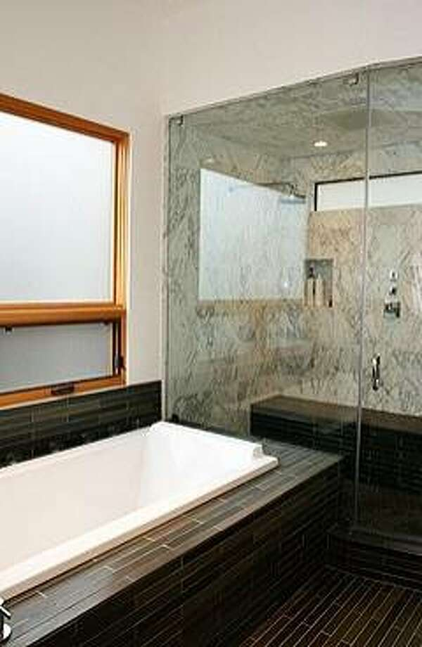 One of three full bathrooms, the master bath has a steam room and separate tub. Photo: The Grubb Co.