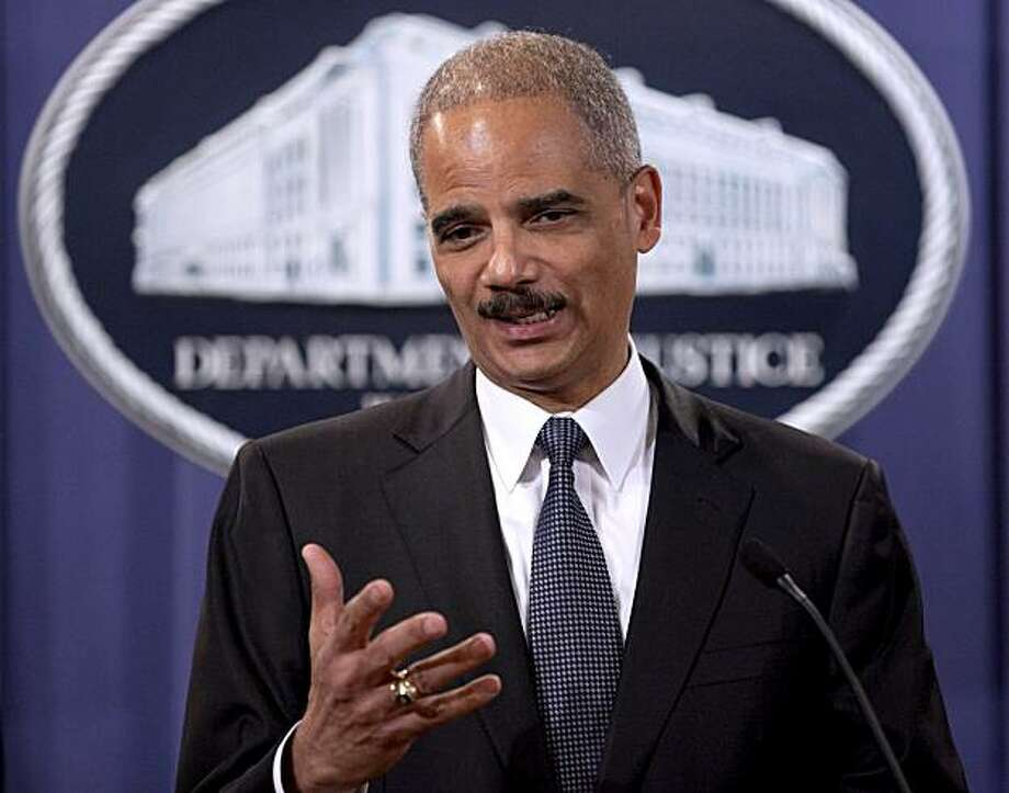 "Attorney General Eric Holder takes part in a news conference at the Justice Department in Washington, Monday, Dec. 6, 2010, to announce the results to date of ""Operation Broken Trust,"" a three and a half month operation targeting investment fraud,. Photo: Evan Vucci, Associated Press"