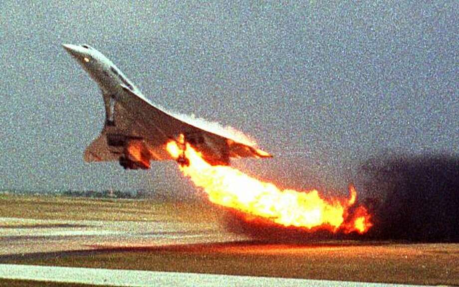 FILE - In this July 25, 2000, Air France Concorde flight 4590 takes off with fire trailing from its engine on the left wing from Charles de Gaulle airport in Paris.  A French court has found Monday Dec.6, 2010, that Continental Airlines, Inc. and one of its mechanics, John Taylor, guilty in connection with the 2000 crash of the Concorde jet outside Paris which killed 113 people. (AP Photo/Toshihiko Sato, File) MANDATORY CREDIT PHOTOGRAPHER TOSHIHIKO SATO  JAPAN OUT Photo: Toshihiko Sato, AP