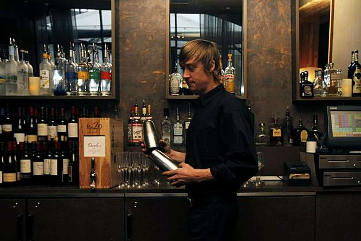 Jason Wickler, a bartender at Americano, sets up the bar for incoming costumers in San Francisco, Calif., on Dec. 05, 2010. Sen. Mark Leno has introduced a bill that would allow bars to return to making and selling
