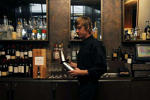 "Jason Wickler, a bartender at Americano, sets up the bar for incoming costumers in San Francisco, Calif., on Dec. 05, 2010.   Sen. Mark Leno has introduced a bill that would allow bars to return to making and selling ""infused"" drinks in San Francisco, Calif., on Dec. 05, 2010. Photo: Michelle Gachet, The Chronicle"