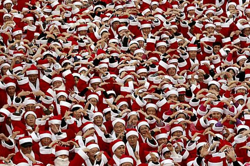 1,004 South Korean volunteers wearing Santa Claus costumes pose in a campaign to raise money for a charity donation in Seoul, South Korea, Tuesday, Dec. 1, 2009. Christmas is one of the biggest holidays in South Korea where over half of the population of 48 million are Christians.