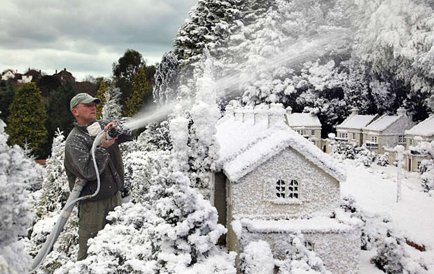 Steve Hanlon sprays false snow over the models at Babbacombe Model Village on December 1, 2009, in Torquay, England. Every year, to celebrate Christmas, the Devon tourist attraction creates a winter wonderland among the miniature world on display to the public. Many parts of the UK experienced the first frosts of the winter this morning as temperatures fell below freezing and snow is even forecast for some parts of the country.