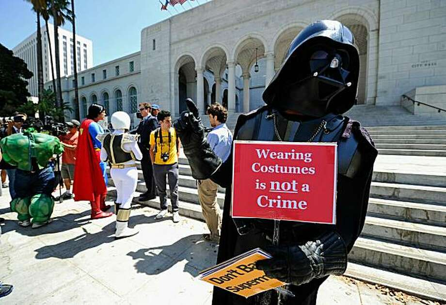 Chris Mitchell (R), wears a Darth Vader costume and protests with fellow costume characters Superman, The Hulk and The White Ranger at the Los Angeles City Hall on August 31, 2010 in Los Angeles, California. The super hero impersonators were protesting the arrests made by the Los Angeles Police Department of costumed characters along Hollywood Boulevard's Walk of Fame.  According to the LAPD, officers received reports of tourists being aggressively solicited by the costumed superheroes, resulting in arrests along Hollywood Boulevard. Photo: Kevork Djansezian, Getty Images