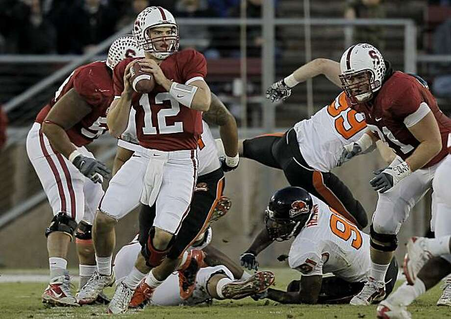 Stanford quarterback Andrew Luck (12) looks to throw in the first half against the Oregon State Beavers at Stanford Stadium on Saturday. Photo: Michael Macor, The Chronicle