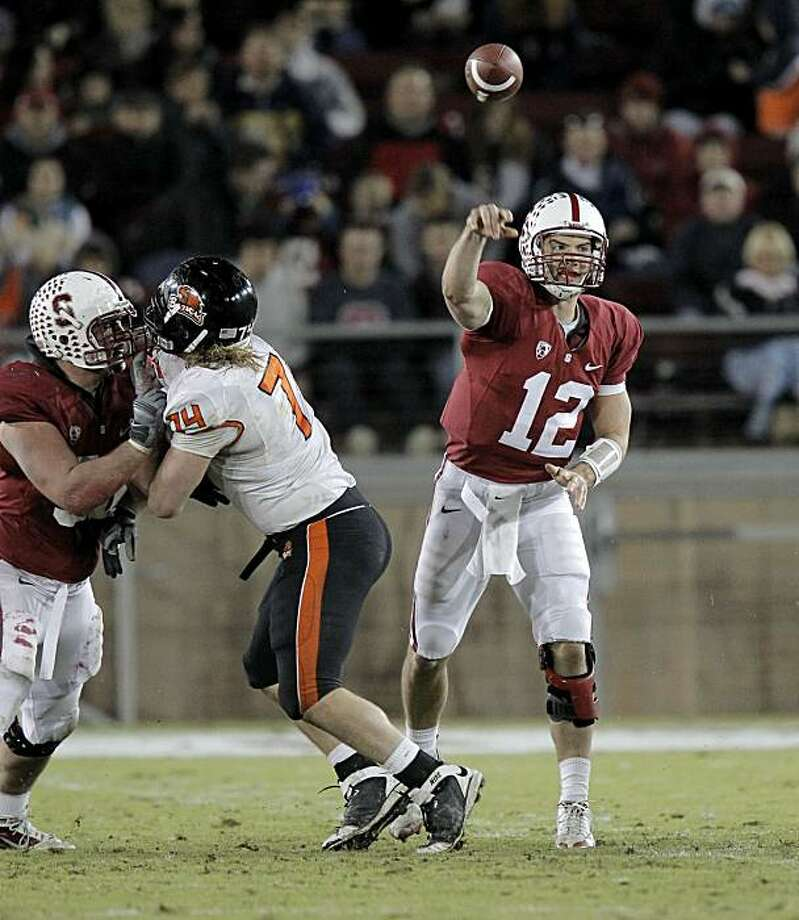Stanford quarterback Andrew Luck (12) throws in the first half against the Oregon State Beavers at Stanford Stadium on Saturday. Photo: Michael Macor, The Chronicle