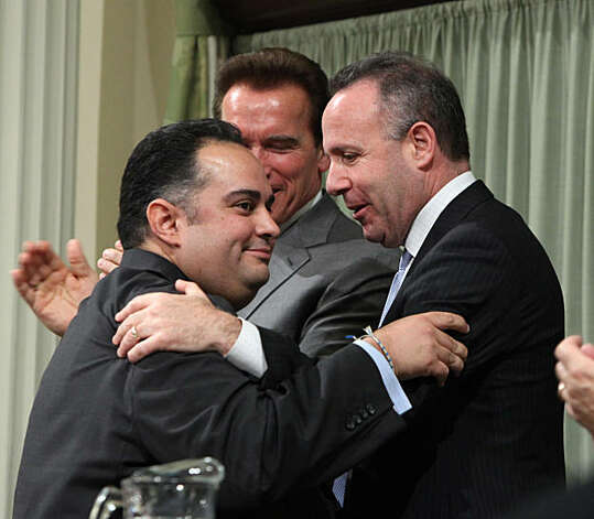 Assemblyman John A. Perez, D-Los Angeles,  left, receives congratulations from state Senate President Pro Tem Darrell Steinberg, D-Sacamento, right, after being sworn-in as the 68th Speaker of the California Assembly during ceremonies held at the Capitolin Sacramento, Calif., Monday, March 1,  2010.  Perez replaces Assembly Speaker Karen Bass, D-Los Angeles, who is being termed out. In the background is Gov. Arnold Schwarzengger. Photo: Rich Pedroncelli, AP