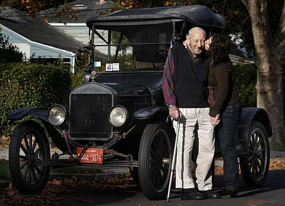 Documentary filmmaker Shaleece Haas visits with her 97-year-old grandfather Milton Cavalli and his Ford Model T at his home in Redwood City, Calif., on Tuesday, Nov. 30, 2010. Cavalli was featured in a documentary produced and directed by Haas on elderly drivers. Photo: Paul Chinn, The Chronicle