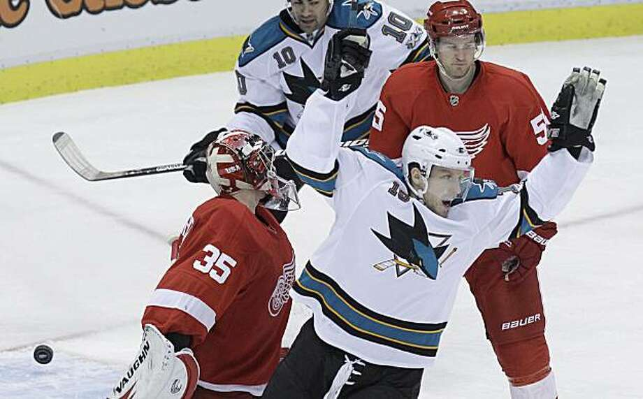 San Jose Sharks right wing Dany Heatley (15) celebrates his goal on Detroit Red Wings goalie Jimmy Howard (35) during the second period of an NHL hockey game in Detroit, Monday, Dec. 6, 2010. Photo: Carlos Osorio, AP