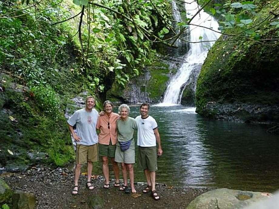 Brad Robinson of San Francisco with Hilary Hart, Martine Habib and Roger Hiscox at Wigmore's waterfall on Rarotonga, Cook Islands. Photo: Courtesy Of Brad Robinson