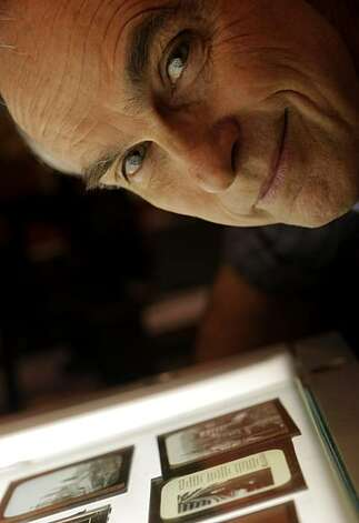 David Kiehn looks over the old glass negatives from San Francisco from 1906 at the the Niles Essanay Silent Film Museum, Monday Nov. 29, 2010, in Fremont, Calif. Photo: Lacy Atkins, The Chronicle