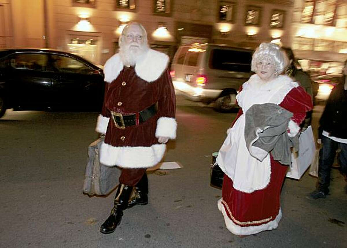 Santa Claus and Mrs. Claus leave the lighting of an 85 foot Christmas tree at Union Square on Friday in San Francisco.