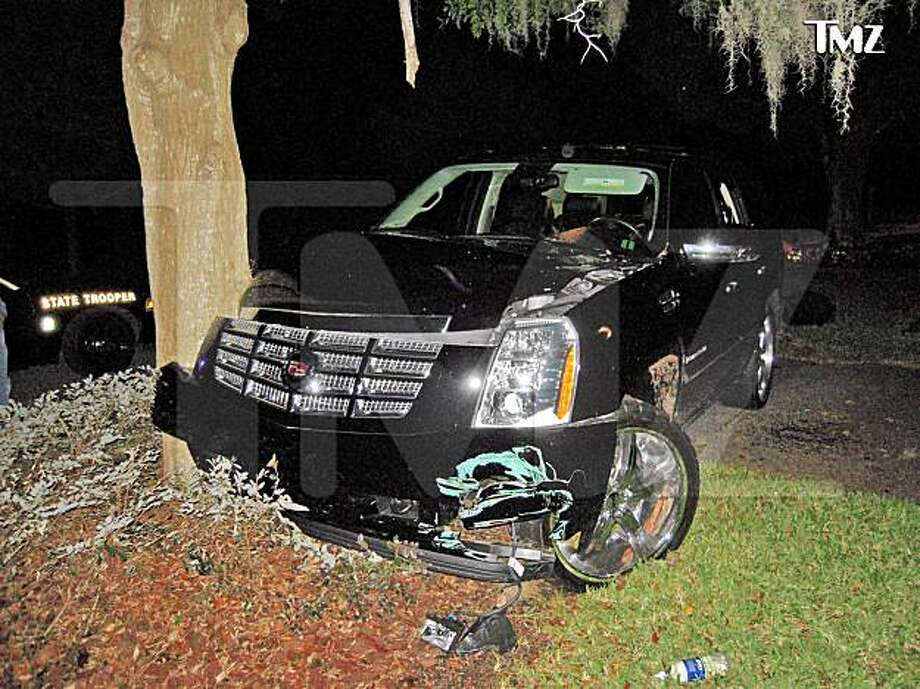 This photo taken Nov. 27, 2009 and provided by the celebrity Web site TMZ.com shows a Cadillac Escalade that Tiger Woods crashed into a tree outside his home in Windermere, Fla. (AP Photo/TMZ) NO SALES. NORTH AMERICA USE ONLY.  USE AFTER DEC. 6 RESTRICTED BY SOURCE Photo: AP