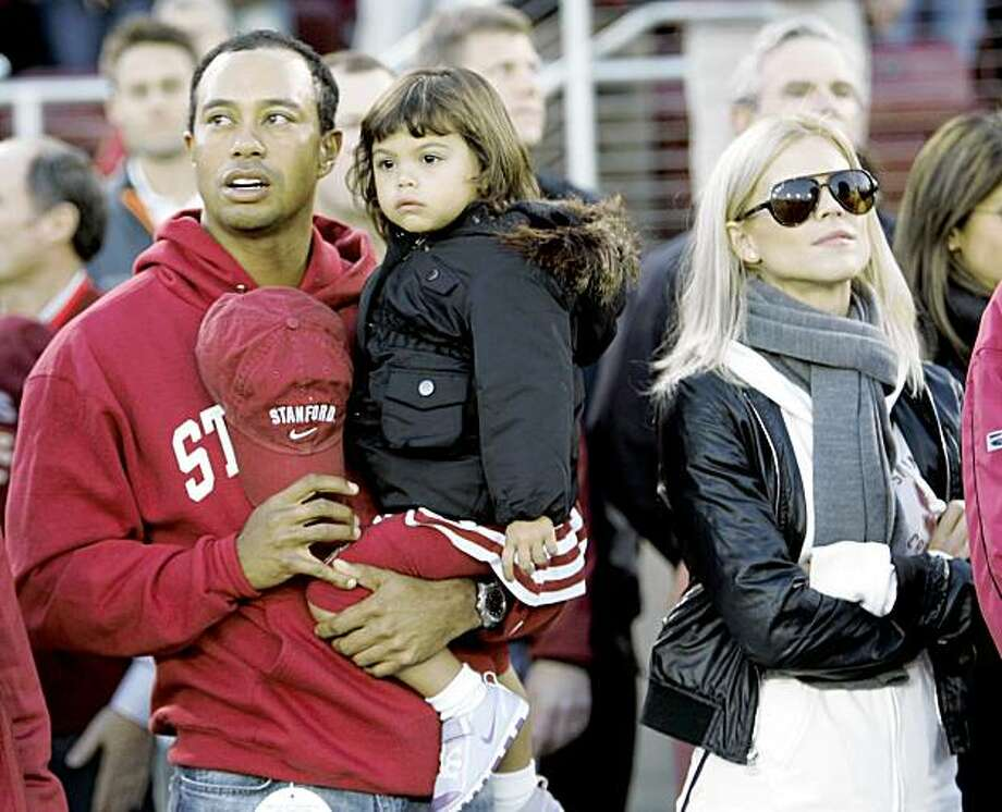 Tiger Woods with his daughter Sam and wife Elin are seen before the start of a NCAA college football game between Stanford and California in Stanford, Calif., in this Nov. 21, 2009 file photo. Tiger Woods was injured early Friday Nov. 27, 2009 when he lost control of his SUV outside his Florida mansion, and a local police chief said Woods' wife used a golf club to smash out the back window to help get him out. Photo: Marcio Jose Sanchez, AP