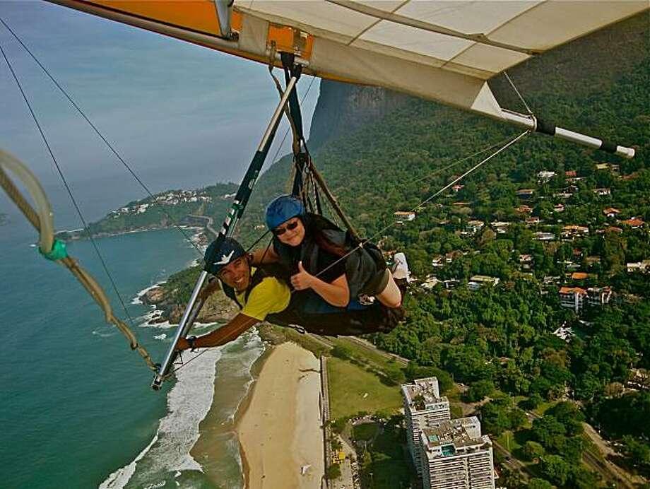 Judi Quan of Oakland hang gliding in Rio de Janeiro, Brazil. Photo: *