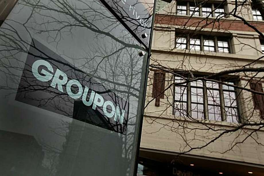CHICAGO, IL - NOVEMBER 30:  A sign marks the location of the Groupon headquarters on November 30, 2010 in Chicago, Illinois. Rumors are circulating that Google is close to reaching a deal to buy Groupon for a reported $5.3 billion. Photo: Scott Olson, Getty Images